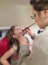 Actress Adeleine Jubilee Whittle (Young Audrey) getting her spooky makeup done by Sarah Tonguis!