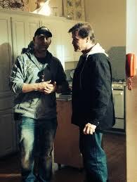 Writer/Director John Fallon discusses a scene with star Michael Pare.